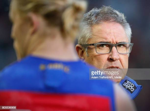 Chris Fagan Senior Coach of the Lions addresses his players during the 2017 AFL round 15 match between the Essendon Bombers and the Brisbane Lions at...