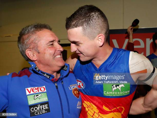 Chris Fagan Senior Coach of the Lions celebrates with Tom Rockliff of the Lions during the 2017 AFL round 15 match between the Essendon Bombers and...
