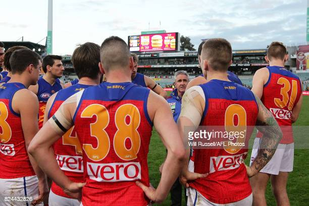 Chris Fagan Senior Coach of the Lions speaks to the team after their defeat during the round 19 AFL match between the West Coast Eagles and the...