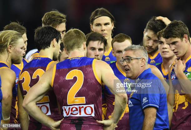 Chris Fagan the coach of the Lions talks to his players during the round five AFL match between the Western Bulldogs and the Brisbane Lions at Etihad...