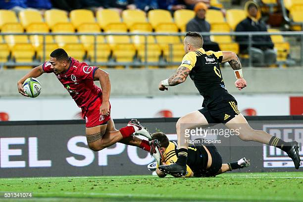 Chris FeauaiSautia of the Reds is tackled by Wes Goosen of the Hurricanes during the round 12 Super Rugby match between the Hurricanes and the Reds...