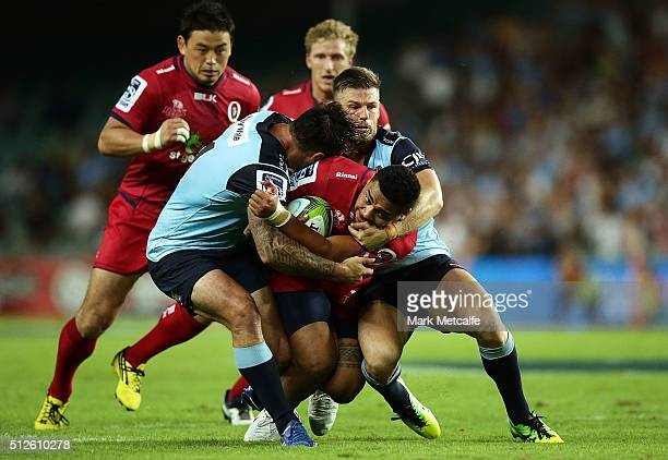 Chris FeauaiSautia of the Reds is tackled during the round one Super Rugby match between the Waratahs and the Reds at Allianz Stadium on February 27...
