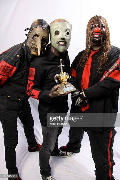 Chris Fehn Corey Taylor and Shawn Crahan of Slipknot pose for a studio portrait session holding a Metal Hammer Golden Gods award backstage at the...
