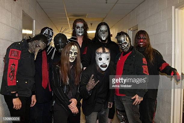 Chris Fehn Paul Gray Craig Jones Joey Jordison Jim Root Corey Taylor Mick Thomson Sid Wilson and Shawn Crahan of Slipknot pose backstage at The...