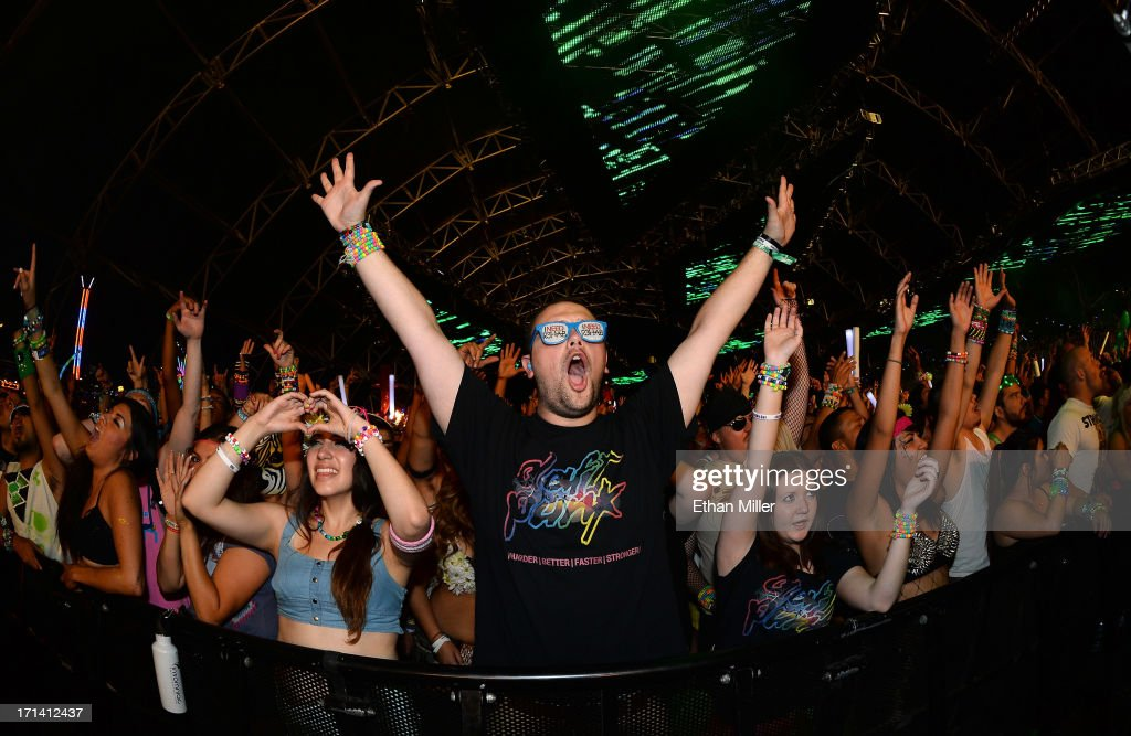 Chris Felt (C) of Michigan reacts during a performance by DJs AN21 and Max Vangeli at the 17th annual Electric Daisy Carnival at Las Vegas Motor Speedway on June 23, 2013 in Las Vegas, Nevada.