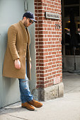 Chris Fenimore of Carson Street Clothiers wears Garrett Leight sunglasses an Our Legacy jacket Ami sweater Salvatore Piccolo shirt Michael Bastian...