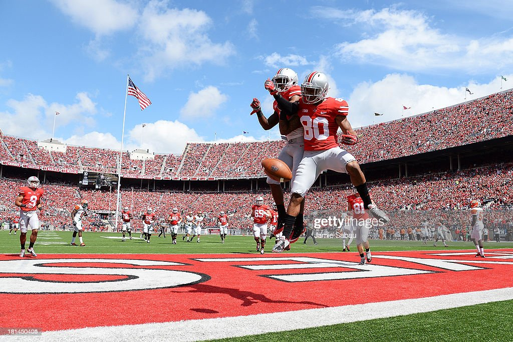 Chris Fields of the Ohio State Buckeyes celebrates his 16yard touchdown catch in the second quarter against the Florida AM Rattlers with teammate...