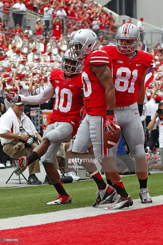 Chris Fields #80 of the Ohio State Buckeyes is congratulated by Corey Brown #10 of the Ohio State Buckeyes and Nick Vannett #81 of the Ohio State Buckeyes after scoring a touchdown against the Buffalo Bulls during the third quarter on August 31, 2013 at Ohio Stadium in Columbus, Ohio. Ohio State defeated Buffalo 40-20.