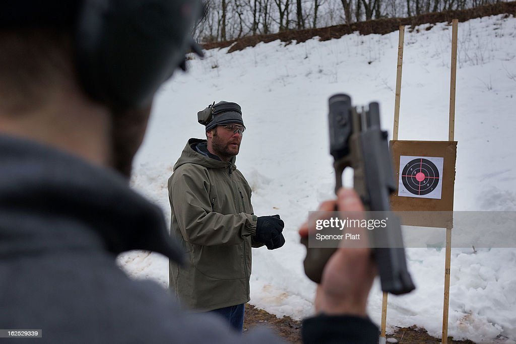 Chris Fields teaches students to shoot their pistols at a class taught by King 33 Training at a shooting range on February 24, 2013 in Wallingford, Connecticut. King 33 Training, a company that trains and educates individuals on the safe and proper use of guns and other uses of protective force, offers classes to marksmen of all levels. The Connecticut company offers training for clients interested in maintaining a safe environment for themselves, their families, and those around them. Connecticut, home to a number of gun manufactures including Colt Defense, is a state with conflicting views on guns and gun ownership. Currently the state has some of the strictest gun control laws in the nation and its current governor Daniel Malloy is pushing for tougher measures following the shootings at the Sandy Hook School.