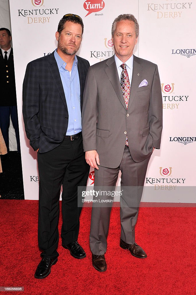 Chris Fischer of the History Channel and Mayor of Louisville Greg Fischer attend the 139th Kentucky Derby at Churchill Downs on May 4, 2013 in Louisville, Kentucky.