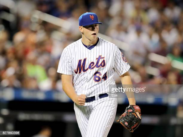 Chris Flexen of the New York Mets celebrates the final out of the fourth inning against the Texas Rangers during interleague play on August 8 2017 at...
