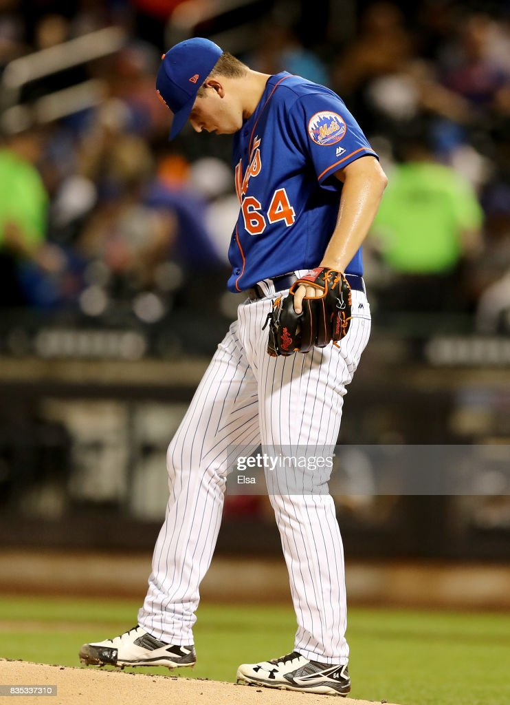 Chris Flexen #64 of the New York Mets reacts in the second inning against the Miami Marlins on August 18, 2017 at Citi Field in the Flushing neighborhood of the Queens borough of New York City.