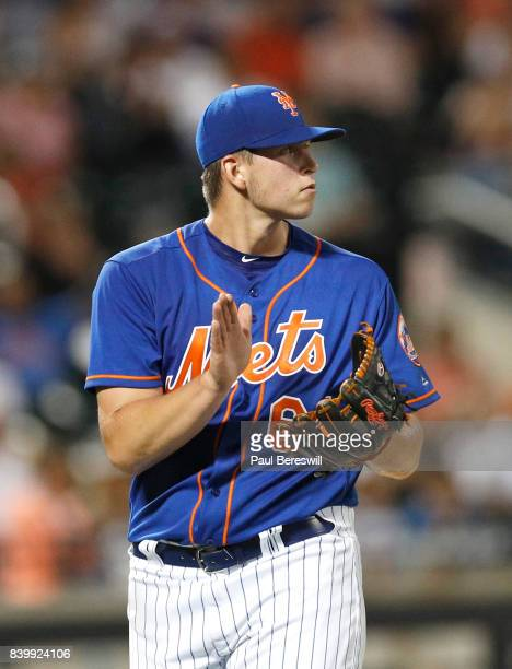 Chris Flexen of the New York Mets reacts to a great play in the outfield by clapping his hands in an MLB baseball game against the Miami Marlins on...