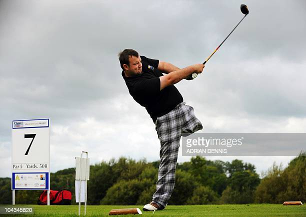 Chris Foster hits a drive on the 7th tee during the Disabled British Open golf tournament at East Sussex National golf course near Uckfield on...