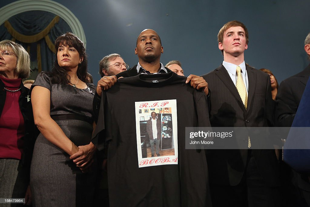 Chris Foye, who's son Chris Owens was killed by a stay bullet in Harlem in 2009, stands with survivors and family members of gun violence at a press conference with New York City Mayor <a gi-track='captionPersonalityLinkClicked' href=/galleries/search?phrase=Michael+Bloomberg&family=editorial&specificpeople=171685 ng-click='$event.stopPropagation()'>Michael Bloomberg</a> at City Hall on December 17, 2012 in New York City. Bloomberg, co-chair of Mayors Against Gun Violence presented a series of videos called 'I Demand a Plan' highlighting personal stories representing Americans killed every day by gunfire. The mayor spoke at length condemning last week's mass murder in Newtown, CT, calling for stronger gun-control legislation.
