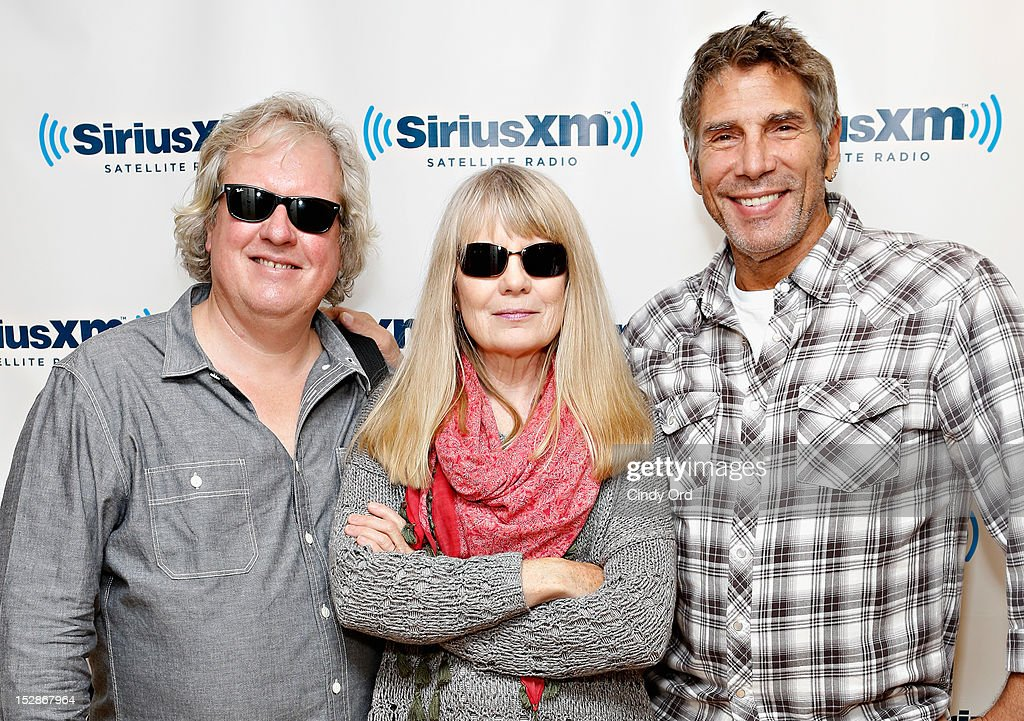 Chris Frantz and Tina Weymouth of Tom Tom Club pose with SiriusXM host Mark Goodman at the SiriusXM Studio on September 27, 2012 in New York City.
