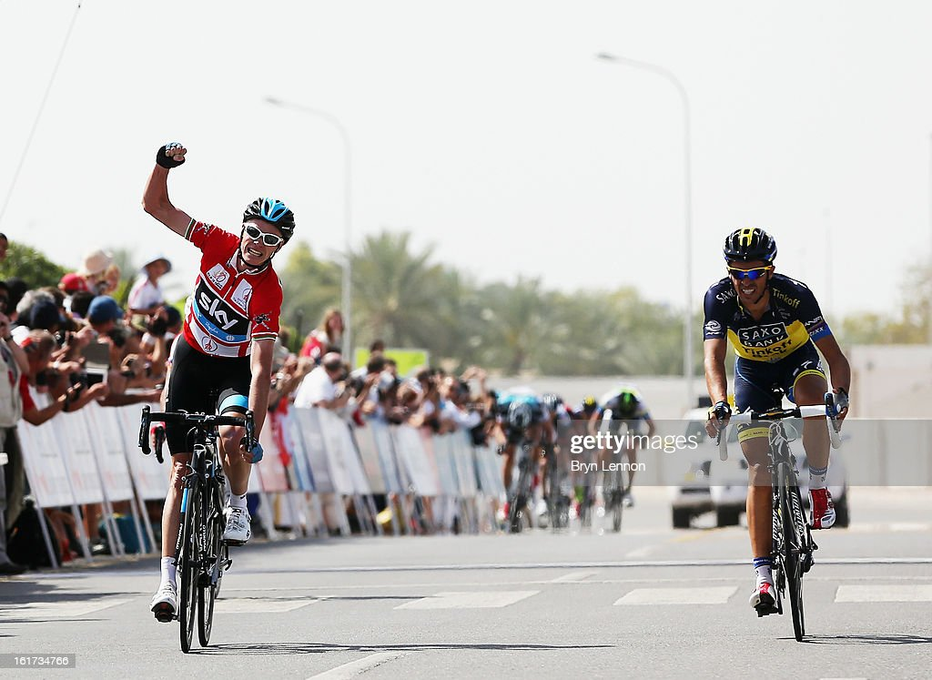 Chris Froome of Great Britain and SKY Procycling celebrates as he beats Alberto Contador of Spain and Team Saxo-Tinkoff over the finishline to win stage five of the Tour of Oman from Al Alam Palace to the Ministry of Housing in Boshar on February 15, 2013 in Boshar, Oman.