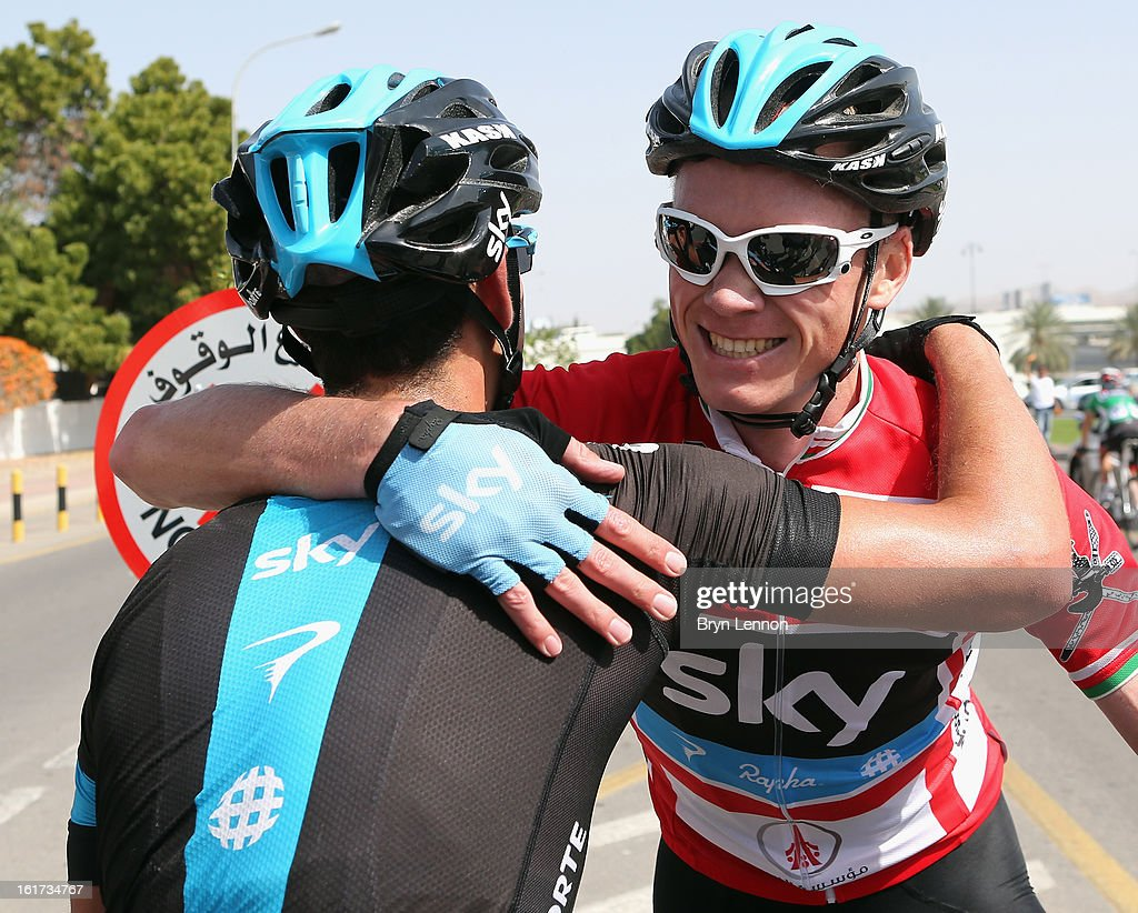 Chris Froome of Great Britain and SKY Procycling celebrates with team mate Richie Porte of Australia after winning stage five of the Tour of Oman from Al Alam Palace to the Ministry of Housing in Boshar on February 15, 2013 in Boshar, Oman.