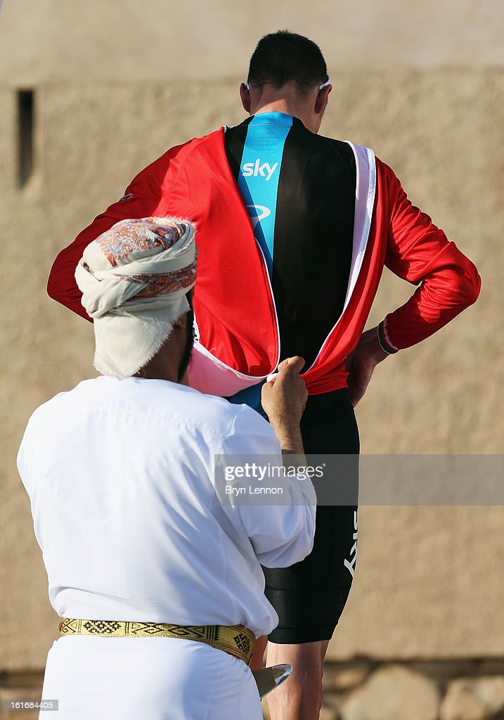 Chris Froome of Great Britain and SKY Procycling pulls on the race leaders jersey after finishing second on stage four of the 2013 Tour of Oman from Al Saltiyah in Samail to Jabal Al Akhdhar (Green Mountain) on February 14, 2013 in Jabal Al Akhdhar, Oman.