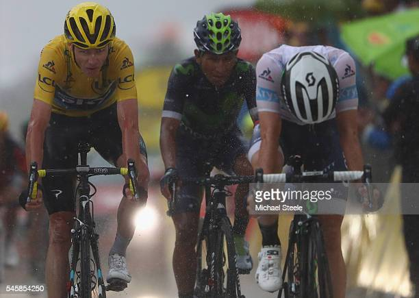 Chris Froome of Great Britain and Team Sky and Nairo Quintana of Colombia and Movistar look ahead as Adam Yates of Great Britain and Orica Bike...