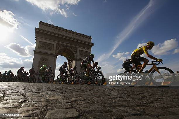 Chris Froome of Great Britain and Team Sky and the rest of the peloton cycle past The Arc de Triomphe during stage twenty one of the 2016 Le Tour de...