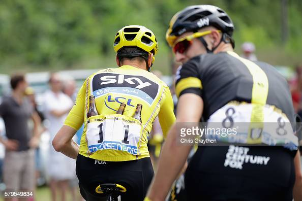 Chris Froome of Great Britain and Team Sky as seen holds a bottle of beer during stage twenty one of the 2016 Le Tour de France from Chantilly to...