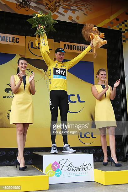 Chris Froome of Great Britain and Team Sky celebrates after retaining the yellow jersey during stage nine of the 2015 Tour de France a 28km team time...