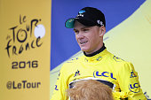 Chris Froome of Great Britain and Team Sky celebrates as he retains the Yellow Jersey following stage twenty of the 2016 Le Tour de France from...