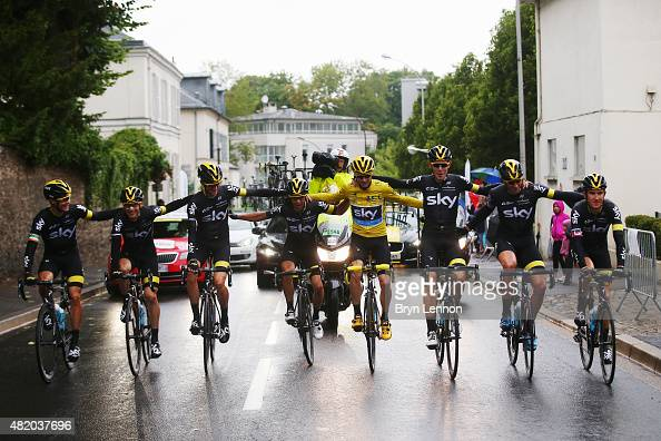 Chris Froome of Great Britain and Team Sky celebrates his overall victory with team mates during the twenty first stage of the 2015 Tour de France a...