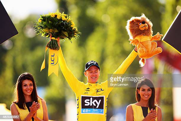 Chris Froome of Great Britain and Team Sky celebrates in the yellow jersey on the podium after overall win following the twenty first stage of the...