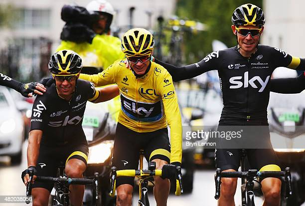 Chris Froome of Great Britain and Team Sky celebrates overall victory with team mates Richie Porte of Australia and Team Sky and Luke Rowe of Great...