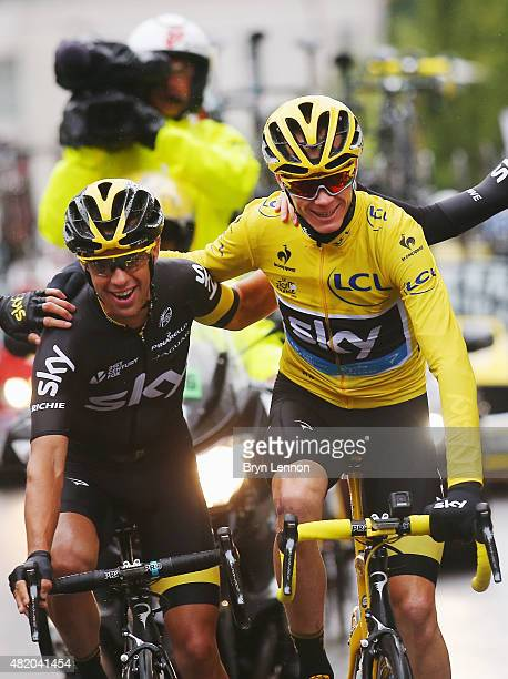 Chris Froome of Great Britain and Team Sky celebrates overall victory with team mate Richie Porte of Australia and Team Sky during the twenty first...