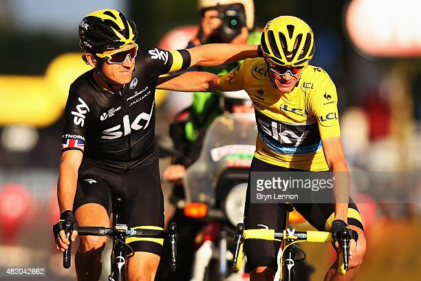 Chris Froome of Great Britain and Team Sky celebrates overall victory with team mate Geraint Thomas of Great Britain and Team Sky following the...