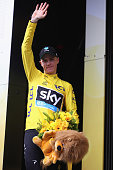 Chris Froome of Great Britain and Team Sky celebrates retaining the yellow jersey after the 146 km mountain stage nineteen of Le Tour de France from...