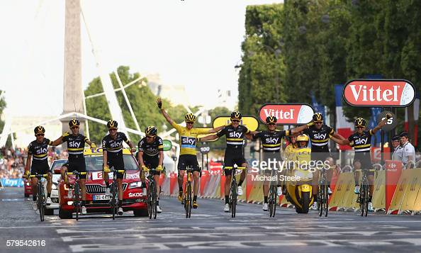 Chris Froome of Great Britain and Team Sky celebrates victory as he crosses the finish line with the rest of The Team Sky riders during stage twenty...