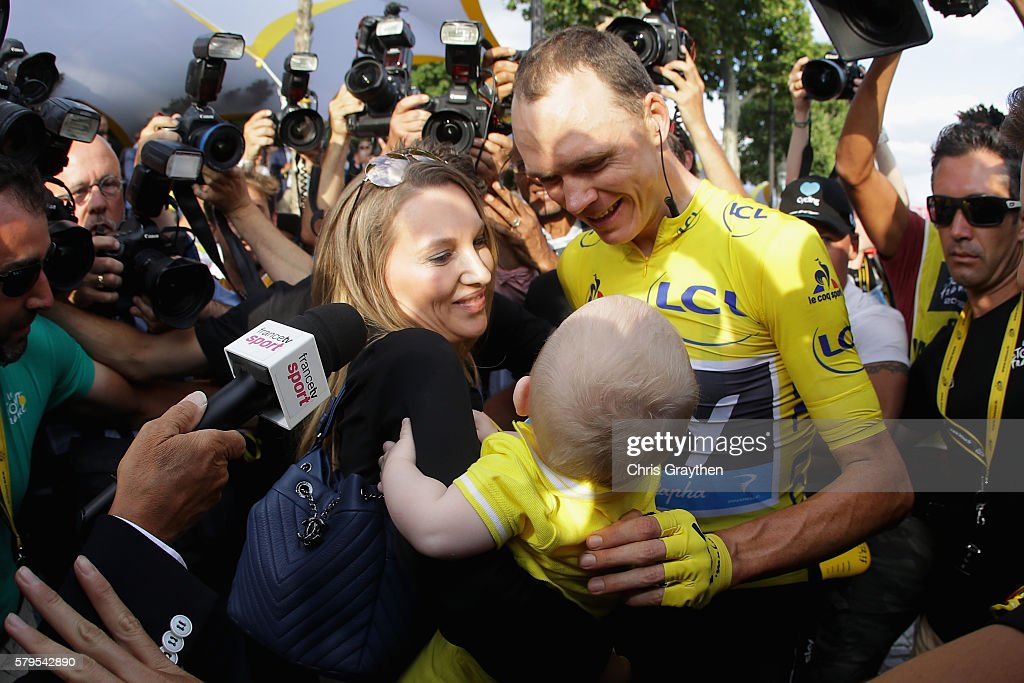 Chris Froome of Great Britain and Team Sky celebrates victoty with his family as he is surrounded by media during stage twenty one of the 2016 Le Tour de France, from Chantilly to Paris Champs-Elysees on July 24, 2016 in Paris, France.