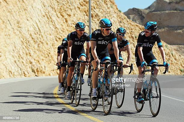 Chris Froome of Great Britain and Team SKY chats to team mate Ben Swift during a training ride ahead of the 2014 Tour of Oman on February 17 2014 in...