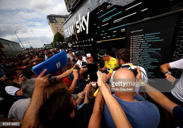 Chris Froome of Great Britain and Team Sky exits the team bus ahead of stage twenty one of Le Tour de France 2017 on July 23 2017 in Paris France