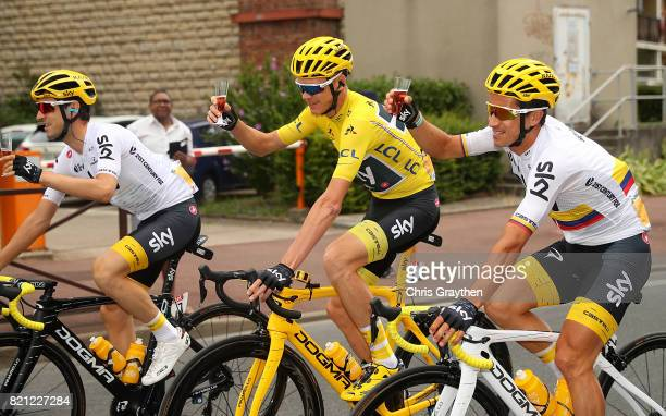 Chris Froome of Great Britain and Team Sky grabs a glass of champagne during stage twenty one of Le Tour de France 2017 on July 23 2017 in Paris...