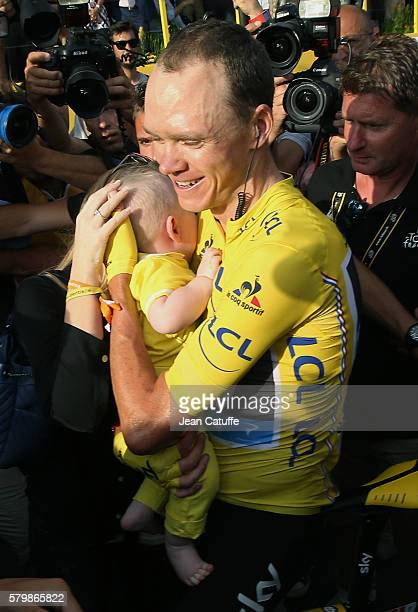 Chris Froome of Great Britain and Team Sky hugs his son Kellan Froome following stage 21 last stage of the Tour de France 2016 between Chantilly and...