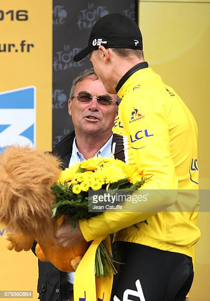 Chris Froome of Great Britain and Team Sky is congratulated by Bernard Hinault following stage 20 of the Tour de France 2016 a stage of 1465 km...