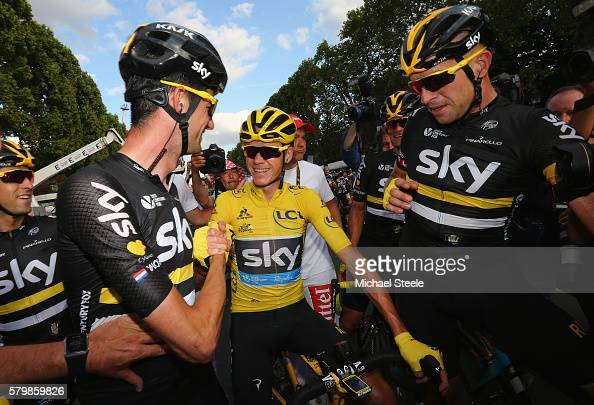 Chris Froome of Great Britain and Team Sky is congratulated by Wouter Poels of the Netherlands and Team Sky and Ian Stannard of Great Britain and...