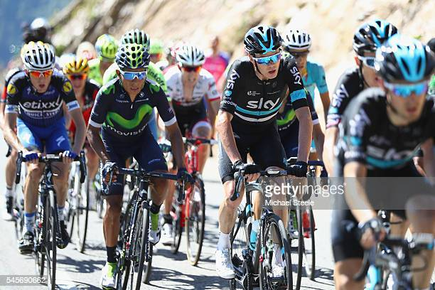 Chris Froome of Great Britain and Team Sky makes his way up the Col de Peyresourde alongside Nairo Quintana of Colombia and Movistar during the 184km...