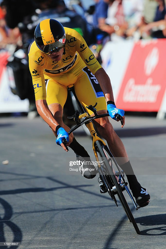 <a gi-track='captionPersonalityLinkClicked' href=/galleries/search?phrase=Chris+Froome&family=editorial&specificpeople=5428054 ng-click='$event.stopPropagation()'>Chris Froome</a> of Great Britain and Team Sky Procycling approaches the finish during stage eleven of the 2013 Tour de France, a 33KM Individual Time Trial from Avranches to Mont-Saint-Michel, on July 10, 2013 in Mont-Saint-Michel, France.