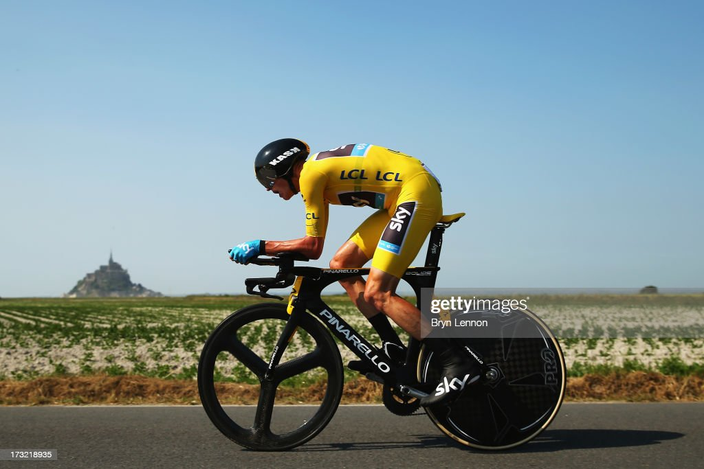 <a gi-track='captionPersonalityLinkClicked' href=/galleries/search?phrase=Chris+Froome&family=editorial&specificpeople=5428054 ng-click='$event.stopPropagation()'>Chris Froome</a> of Great Britain and Team Sky Procycling rides during stage eleven of the 2013 Tour de France, a 33KM Individual Time Trial from Avranches to Mont-Saint-Michel, on July 10, 2013 in Avranches, France.