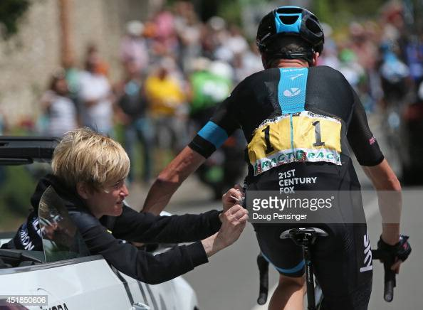 Chris Froome of Great Britain and Team Sky receives medical attention after being involved in a crash early in the race during stage four of the 2014...