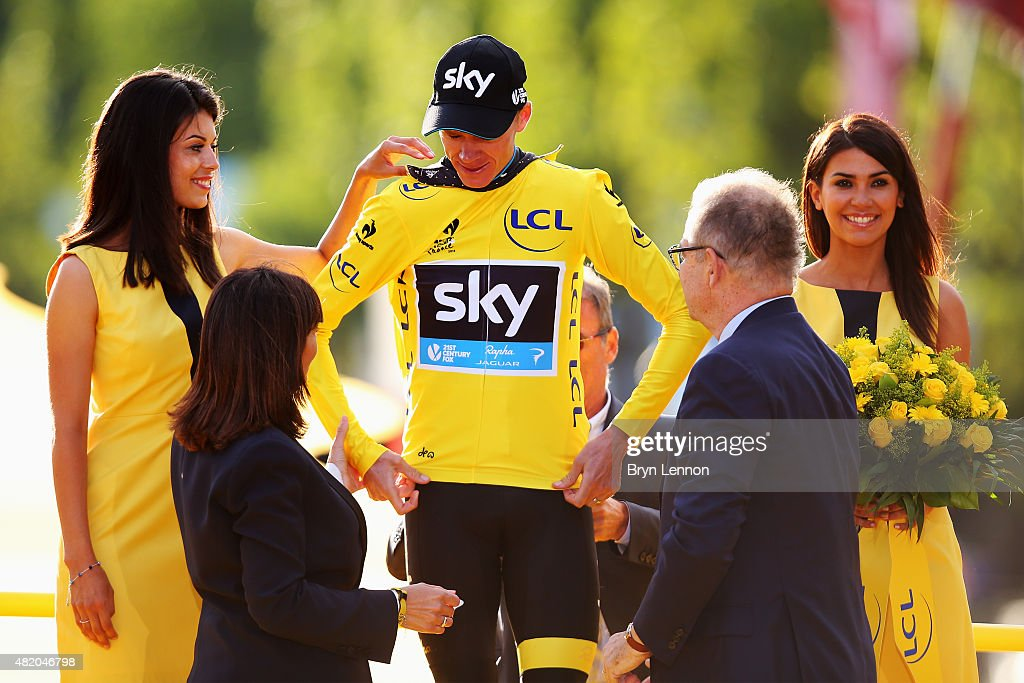Chris Froome of Great Britain and Team Sky receives the yellow jersey on the podium after his overall win following the twenty first stage of the 2015 Tour de France, a 109.5 km stage between Sevres and Paris Champs-Elysees, on July 26, 2015 in Paris, France.