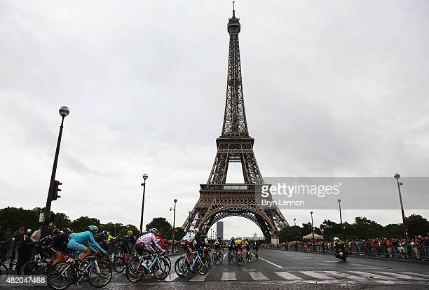 Chris Froome of Great Britain and Team Sky rides past the Eiffel Tower on his way to overall victory during the twenty first stage of the 2015 Tour...
