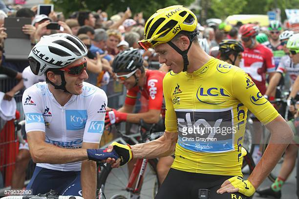 Chris Froome of Great Britain and Team Sky shakes hands with Adam Yates of Great Britain and Orica Greenedge prior to stage twenty one of the 2016 Le...