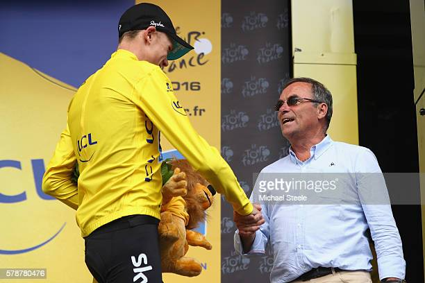 Chris Froome of Great Britain and Team Sky shakes hands with five times Tour winner Bernard Hinault after retaining the race leaders yellow jersey on...